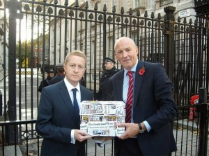 John receiving a petition from the News and Star against possible Police Cuts