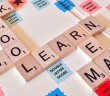 A Scrabble board with words related to school on such as learn, read and maths