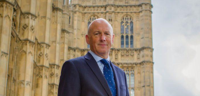 John outside Parliament