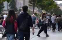 Couple walking down UK high street