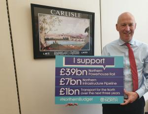 John with sign declaring support for Transport for the North funding